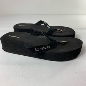 Bebe wedge flip flops women's size 9